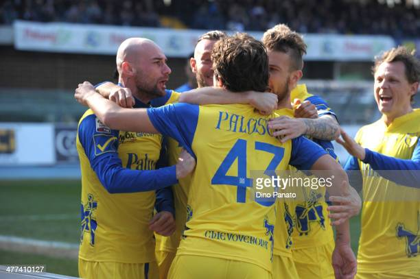 Alberto Paloschi of Chievo Verona celebrates with theit teammates after scoring his team's openig goal from the penalty spot during the Serie A match...