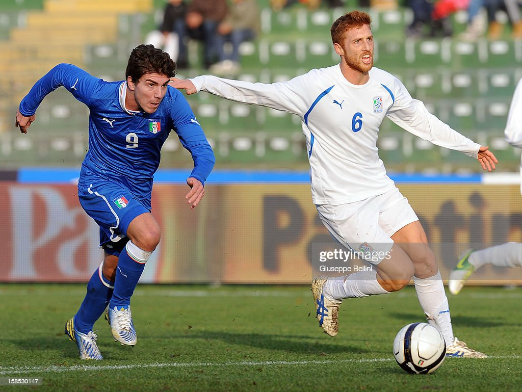 <a gi-track='captionPersonalityLinkClicked' href=/galleries/search?phrase=Alberto+Paloschi&family=editorial&specificpeople=3817495 ng-click='$event.stopPropagation()'>Alberto Paloschi</a> of Italy U21 and Daniele Rosania of Rappresentativa Serie B in action during the friendly match between Italy U21 and Rappresentativa Serie B at Stadio Libero Liberati on December 18, 2012 in Terni, Italy.