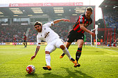 Alberto Paloschi of Swansea City and Simon Francis of Bournemouth compete for the ball during the Barclays Premier League match between AFC...