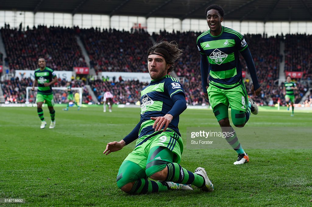 Alberto Paloschi (L) of Swansea City celebrates scoring his team's second goal with his team mate Leroy Fer (R) during the Barclays Premier League match between Stoke City and Swansea City at Britannia Stadium on April 2, 2016 in Stoke on Trent, England.