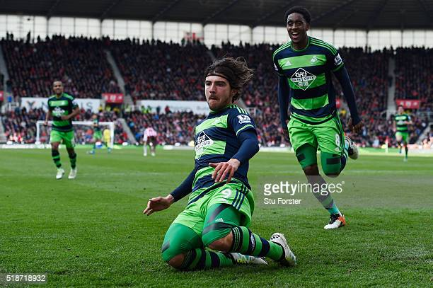 Alberto Paloschi of Swansea City celebrates scoring his team's second goal with his team mate Leroy Fer during the Barclays Premier League match...