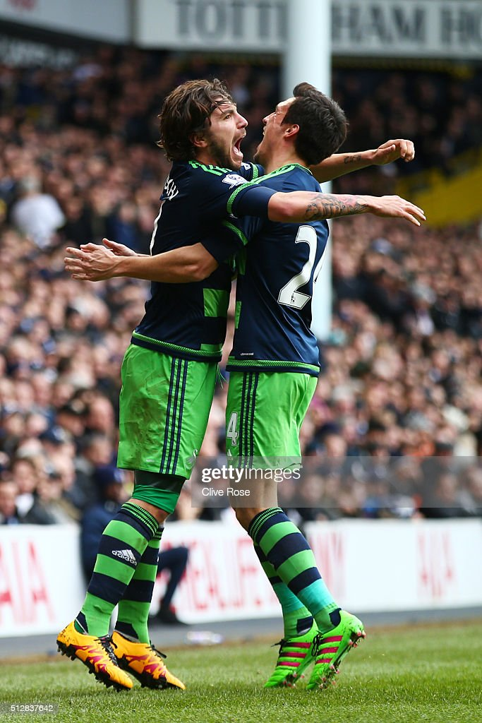 Alberto Paloschi (L) of Swansea City celebrates scoring the opening goal with Jack Cork during the Barclays Premier League match between Tottenham Hotspur and Swansea City at White Hart Lane on February 28, 2016 in London, England.
