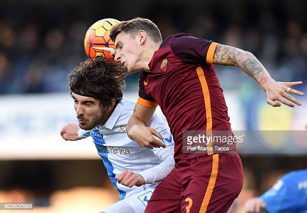 Alberto Paloschi os AC Chievo competes for the ball with Lucas Digne of AS Roma during the Serie A match between AC Chievo Verona and AS Roma at...