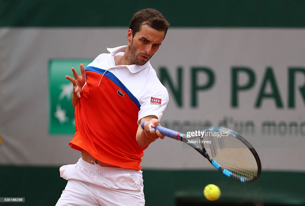 Alberto Ramos Vinolas of Spain hits a forehand during the Men's Singles fourth round match against Milos Raonic of Canada on day eight of the 2016 French Open at Roland Garros on May 29, 2016 in Paris, France.