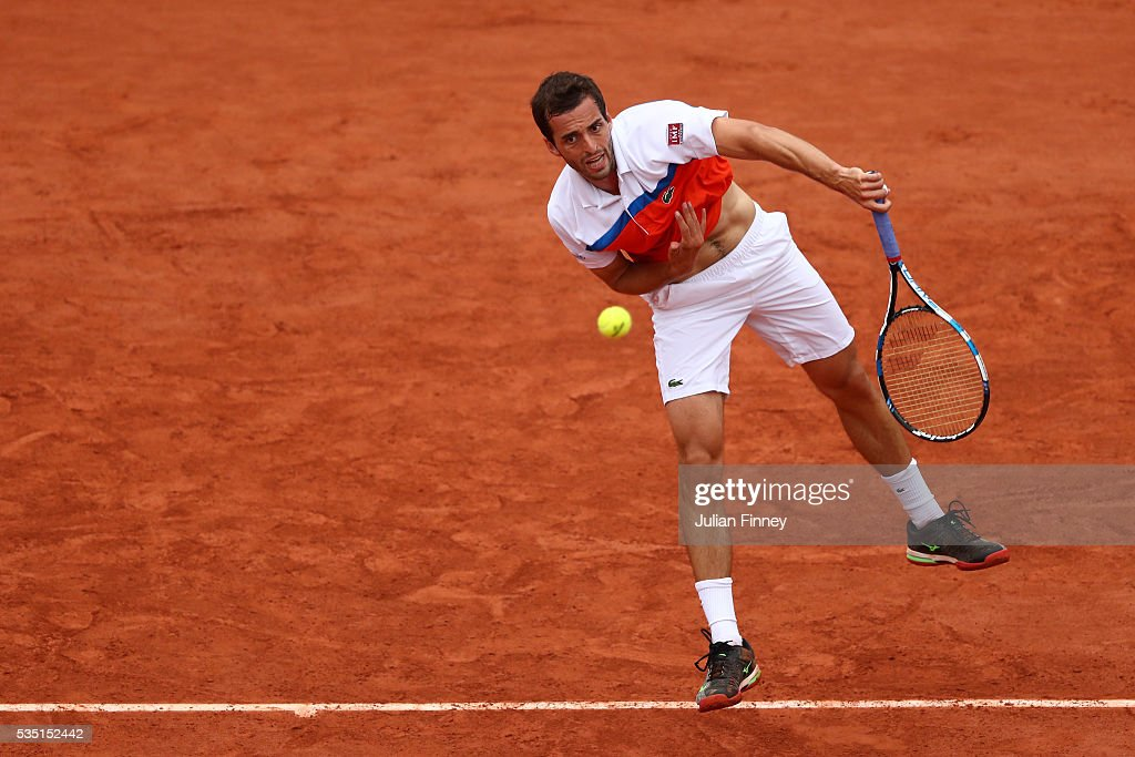 Alberto Ramos Vinolas of Spain serves during the Men's Singles fourth round match against Milos Raonic of Canada on day eight of the 2016 French Open at Roland Garros on May 29, 2016 in Paris, France.