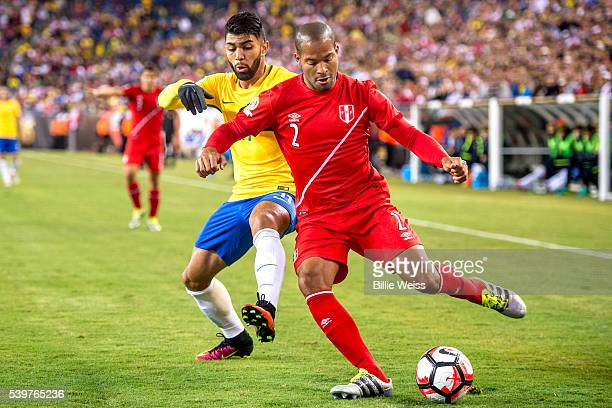 Alberto Rodríguez of Peru struggles for the ball with Gabriel of Brazil during a group B match between Brazil and Peru at Gillette Stadium as part of...