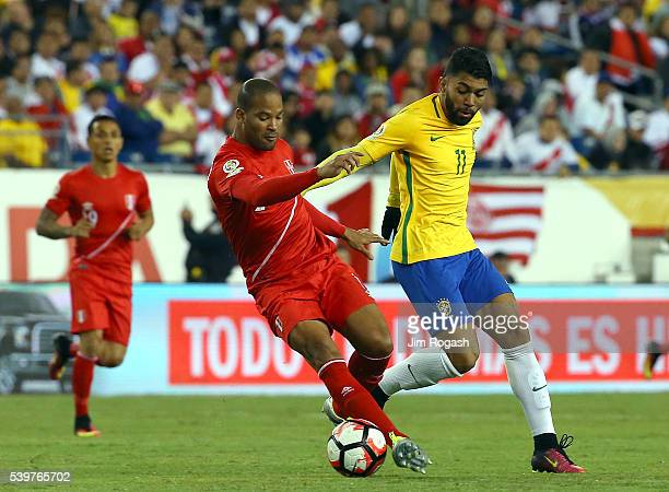 Alberto Rodriguez of Peru and Gabriel of Brazil battle for the ball in the second half during the 2016 Copa America Centenario Group B match against...