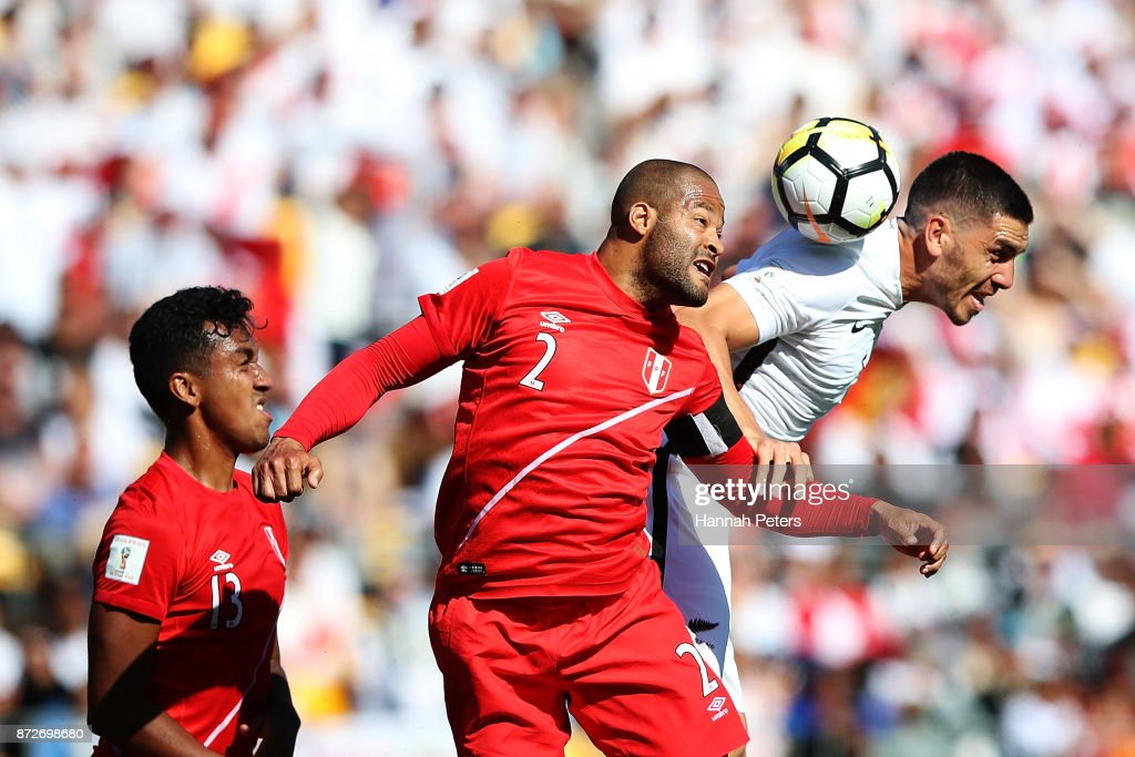 Alberto Rodriguez of Peru competes with Michael Boxall of the All Whites for the ball during the 2018 FIFA World Cup Qualifier match between the New Zealand All Whites and Peru at Westpac Stadium on November 11, 2017 in Wellington, New Zealand.