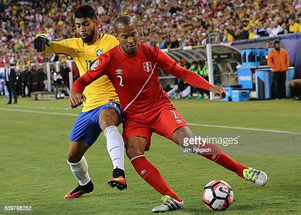 Alberto Rodriguez of Peru gets by Gabriel of Brazil in the first half of the 2016 Copa America Centenario Group B match with Brazil at Gillette...