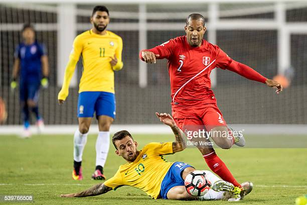 Alberto Rodriguez of Peru handles the ball as he is defended by Lucas Lima of Brazil during a group B match between Brazil and Peru at Gillette...