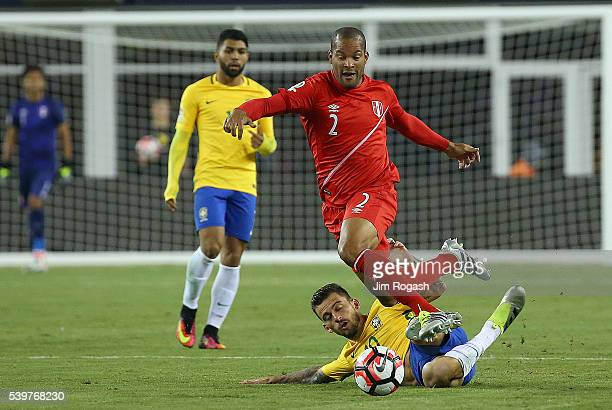Alberto Rodriguez of Peru leaps over Lucas Lima of Brazil running for the ball in the first half during the 2016 Copa America Centenario Group B...