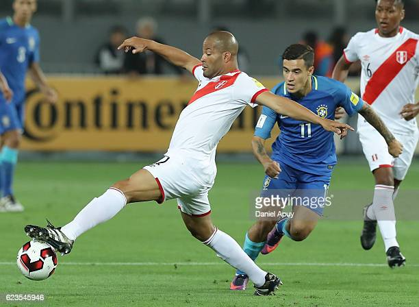 Alberto Rodriguez of Peru tries to reach the ball as he is defended by Philippe Coutinho of Brazil during a match between Peru and Brazil as part of...