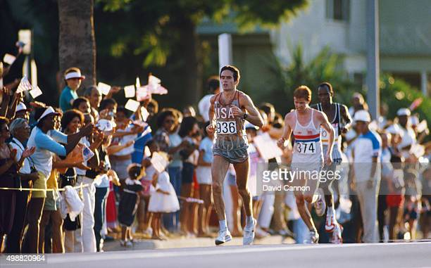 Alberto Salazar of the USA leads Hugh Jones of GBR in the Mens Marathon at the 1984 Los Angeles Olympic Games on August 12 1984 in Los Angeles United...