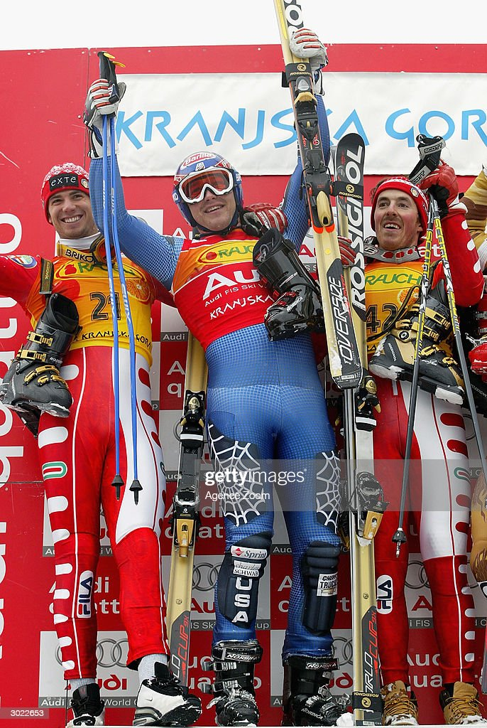 Alberto Schieppati of Italy second place, Bode Miller of USA first place, Alexander Ploner of Italy shared third place on the podium after the FIS Alpine Ski World Cup Men's Giant Slalom on February 28, 2004 in Kranjska Gora, Slovenia.