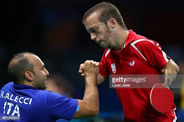 Alberto Seoane of Spain shake hands with Raymond Alecci after competes in the men's singles Table Tennis Class 6 on day 2 of the Rio 2016 Paralympic...