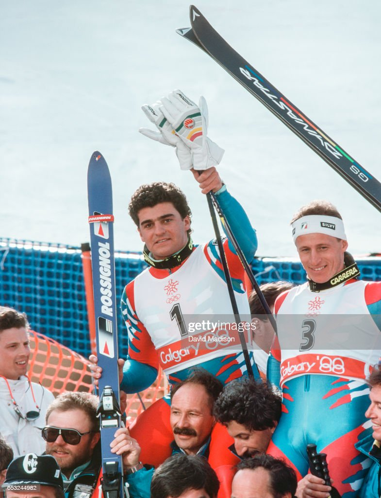 Alberto Tomba #1 and Ivano Camozzi #3 of Italy celebrate their performance in the Giant Slalom event of the Alpine Skiing Competition of the Winter Olympic Games on February 25, 1988 at the Nakiska ski area near Calgary, Canada. Tomba was the gold medalist in the event and Camozzi was fourth.