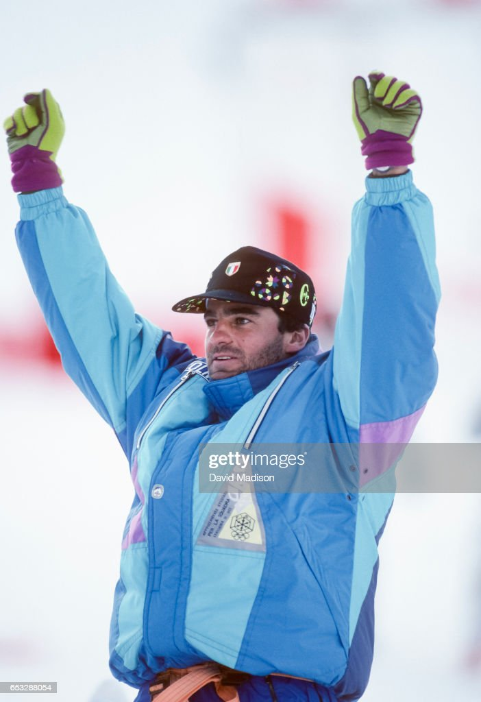 Alberto Tomba #6 of Italy celebrates his gold medal in the Giant Slalom skiing event of the 1992 Winter Olympic Games on February 18, 1992 at Val d'Isere near Albertville, France.