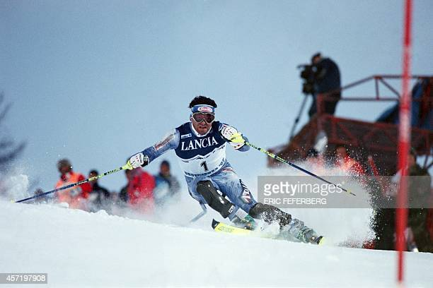 Alberto Tomba of Italy clears a gate during the first run of the men's world championship slalom race in Sestriere 15 February Tomba one of the top...