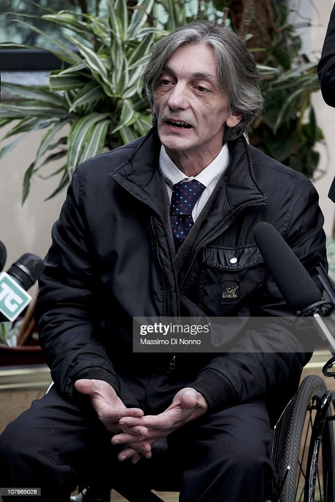 Alberto Torregiani, the son of Pierluigi Torregiani, speaks to media at a press conference also attended by Italian Prime Minister Silvio Berlusconi and Italian politician Daniela Santanche (not pictured) at Linate military airport on January 04, 2011 in Milan, Italy. Alberto Torregiani was shot in the back and was left paralysed during the same gunfight in which his father jeweler Pierluigi Torregiani was killed by militant group PAC (Armed Proletarians for Communism) in 1979. Italy has recalled its ambassador to Brazil to following former Brazilian President Luiz Inacio Lula da Silva's decision on his final day in office not to approve the extradition of Cesare Battisti, deemed responsible for the attack and convicted for a string of murders in the 1970s for which he was tried and convicted in absentia.