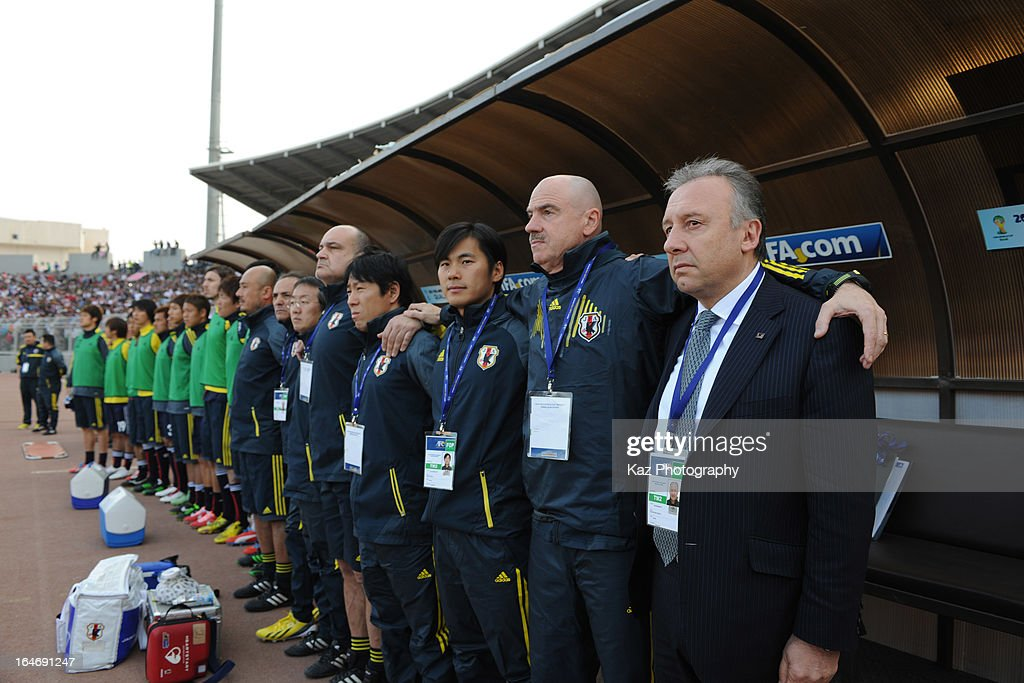 Alberto Zaccheroni, Coach of Japan listens Japanese Anthem with his coaching staff during the FIFA World Cup Asian qualifier match between Jordan and Japan at King Abdullah International Stadium on March 26, 2013 in Amman, Jordan.