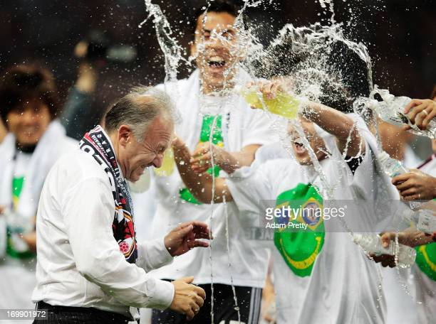Alberto Zaccheroni Head Coach of Japan is soaked by players after the FIFA World Cup qualifier match between Japan and Australia at Saitama Stadium...