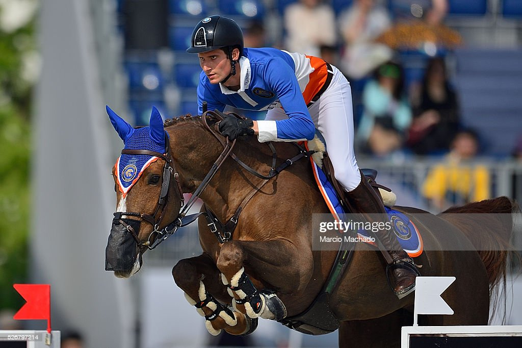 Alberto Zorzi of Italy hiding Fair Light van T Heike during the Global Champions League Team Competition, second round on May 1, 2016 in Shanghai, China.