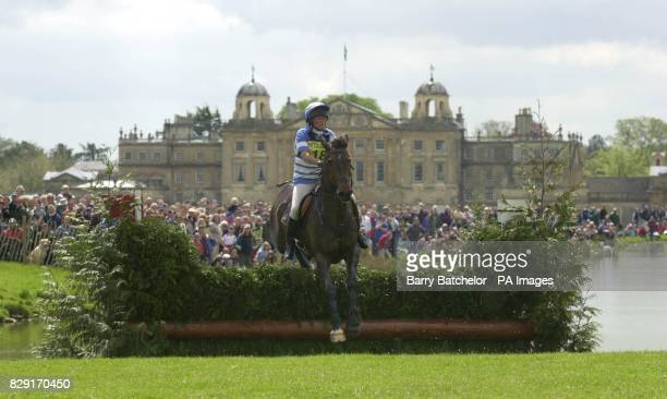 Albie O'G with Jo MarshSmith from East Grinstead climbs out of the Lake with Badminton House in the background during the Cross Country at the...