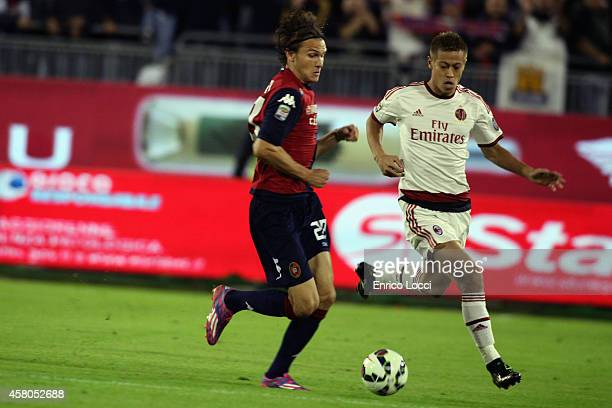 Albin Ekdal of Cagliari and Keisuke Honda of milan during the Serie A match between Cagliari Calcio and AC Milan at Stadio Sant'Elia on October 29...
