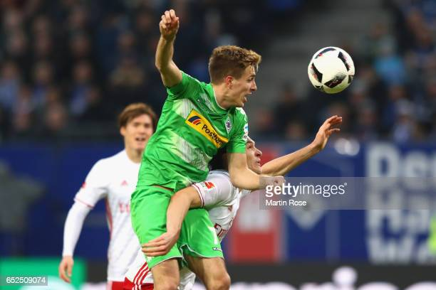 Albin Ekdal of Hamburg battles for the ball with Patrick Hermann of Moenchengladbach during the Bundesliga match between Hamburger SV and Borussia...