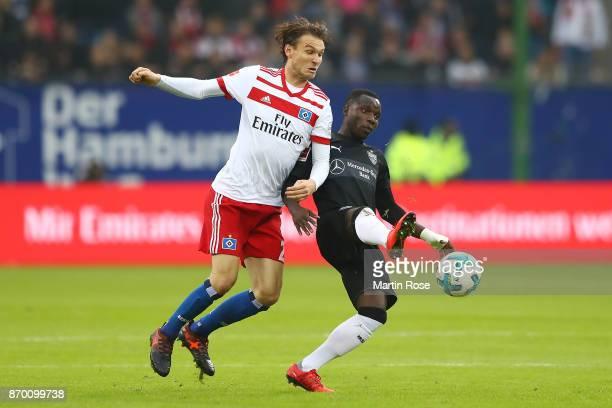 Albin Ekdal of Hamburg fights for the ball with Chadrac Akolo of Stuttgart during the Bundesliga match between Hamburger SV and VfB Stuttgart at...