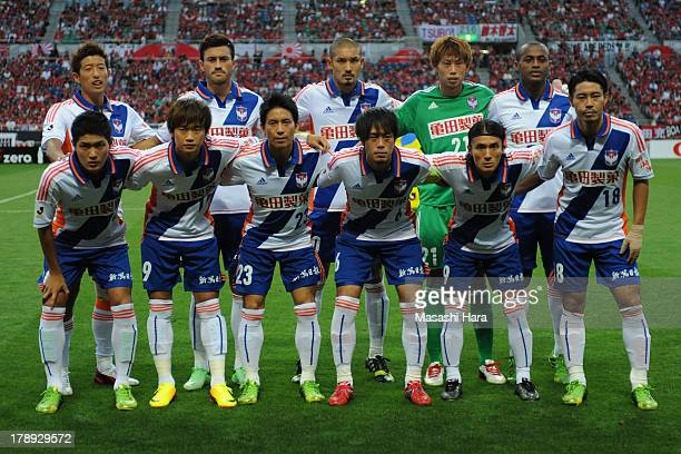 Albirex Nigata players pose for photograph prior to the JLeague match between Urawa Red Diamonds and Albirex Niigata at Saitama Stadium on August 31...