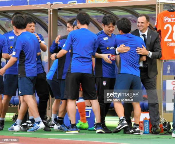 Albirex Niigata new head coach Wagner Lopes celebrates his side's 10 victory with his team staffs after the JLeague J1 match between Albirex Niigata...