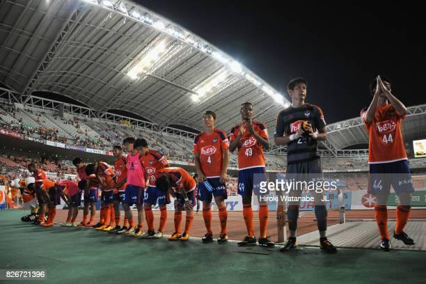 Albirex Niigata players applaud after the 02 defeat in the JLeague J1 match between Albirex Niigata and Yokohama FMarinos at Denka Big Swan Stadium...