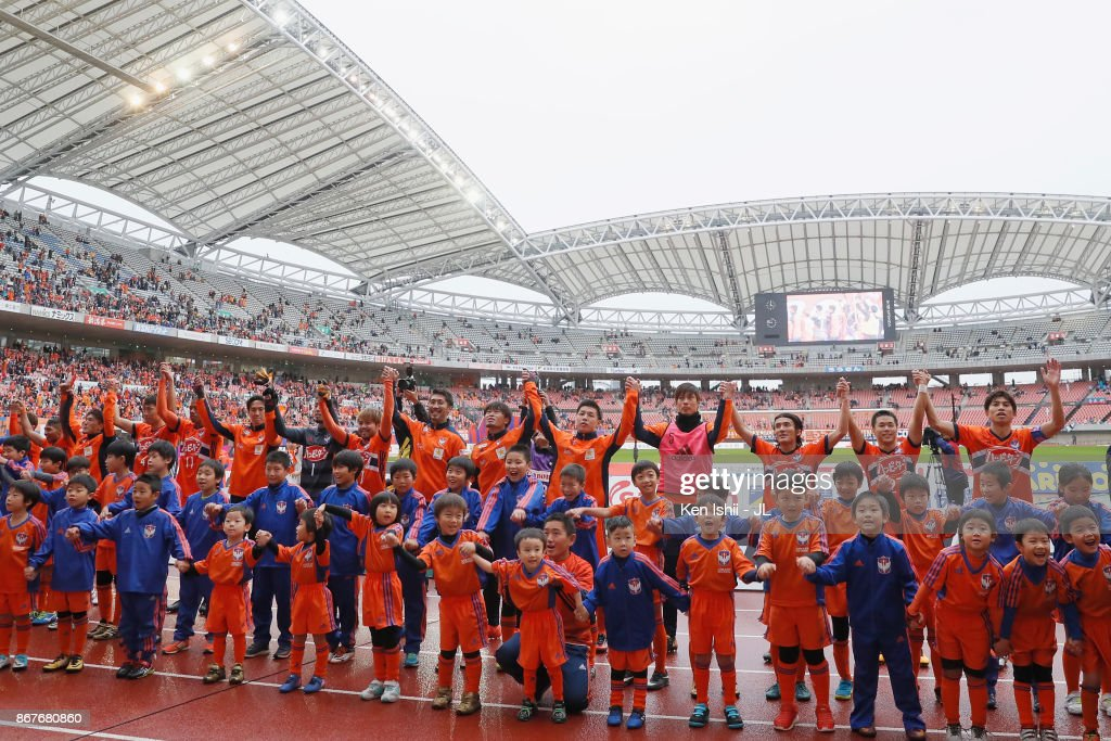 http://media.gettyimages.com/photos/albirex-niigata-players-applaud-supporters-after-their-10-victory-in-picture-id867680860