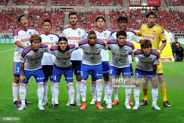Albirex Niigata players line up for the team photos prior to the JLeague match between Urawa Red Diamonds and Albirex Niigata at Saitama Stadium on...