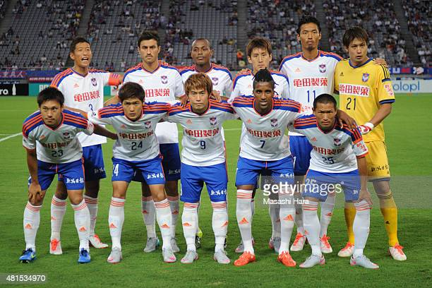 Albirex Niigata players line up for the team photos prior to the JLeague match between FC Tokyo and Albirex Niigata at Ajinomoto Stadium on July 15...