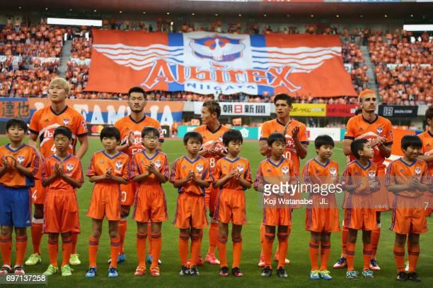 Albirex Niigata players line up prior to the JLeague J1 match between Albirex Niigata and Omiya Ardija at Denka Big Swan Stadium on June 17 2017 in...