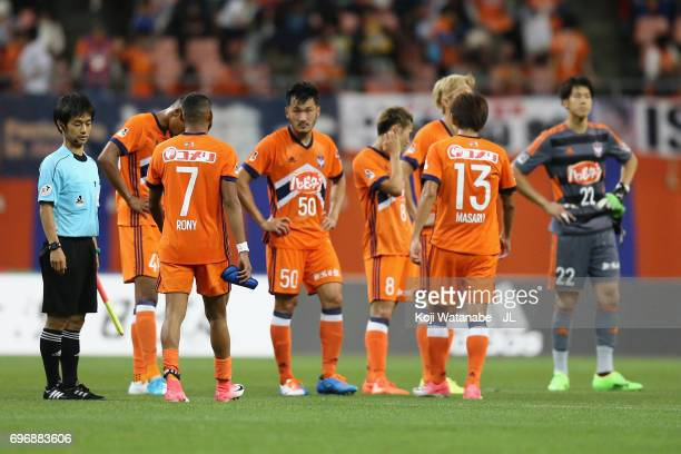 Albirex Niigata players show dejection after the 12 defeat in the JLeague J1 match between Albirex Niigata and Omiya Ardija at Denka Big Swan Stadium...