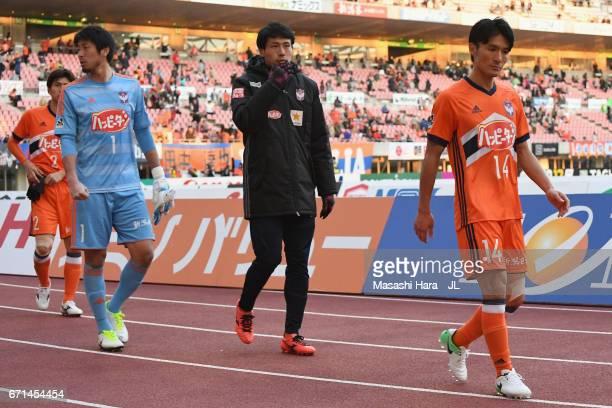 Albirex Niigata players show dejection after their 03 defeat in the JLeague J1 match between Albirex Niigata and FC Tokyo at Denka Big Swan Stadium...