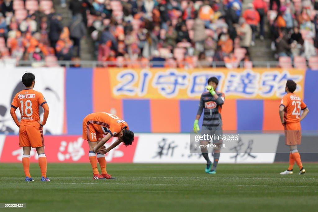 Albirex Niigata players show their dejection after their 2-3 defeat in the J.League J1 match between Albirex Niigata and Gamba Osaka at Denka Big Swan Stadium on April 1, 2017 in Niigata, Japan.