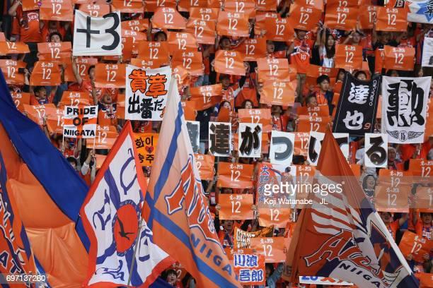 Albirex Niigata supporters cheer prior to the JLeague J1 match between Albirex Niigata and Omiya Ardija at Denka Big Swan Stadium on June 17 2017 in...