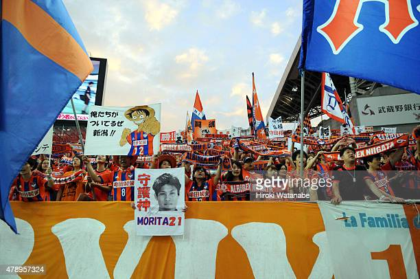 Albirex Niigata supporters cheer prior to the JLeague match between Urawa Red Diamonds and Albirex Niigata at Saitama Stadium on June 27 2015 in...