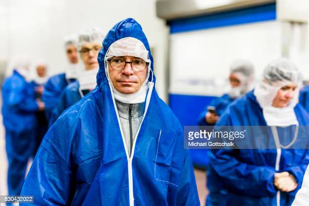 Albrecht Gerber minister for economics wears a special hygienic clothes during his visit to a meat warehouse of German Edeka supermarket cooperative...