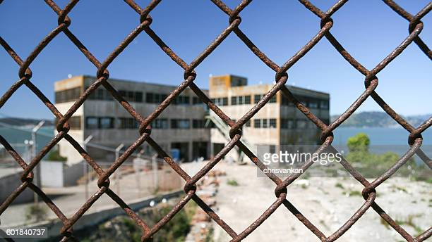 Alcatraz prison seen through chainlink fence, San Francisco, California, America, USA