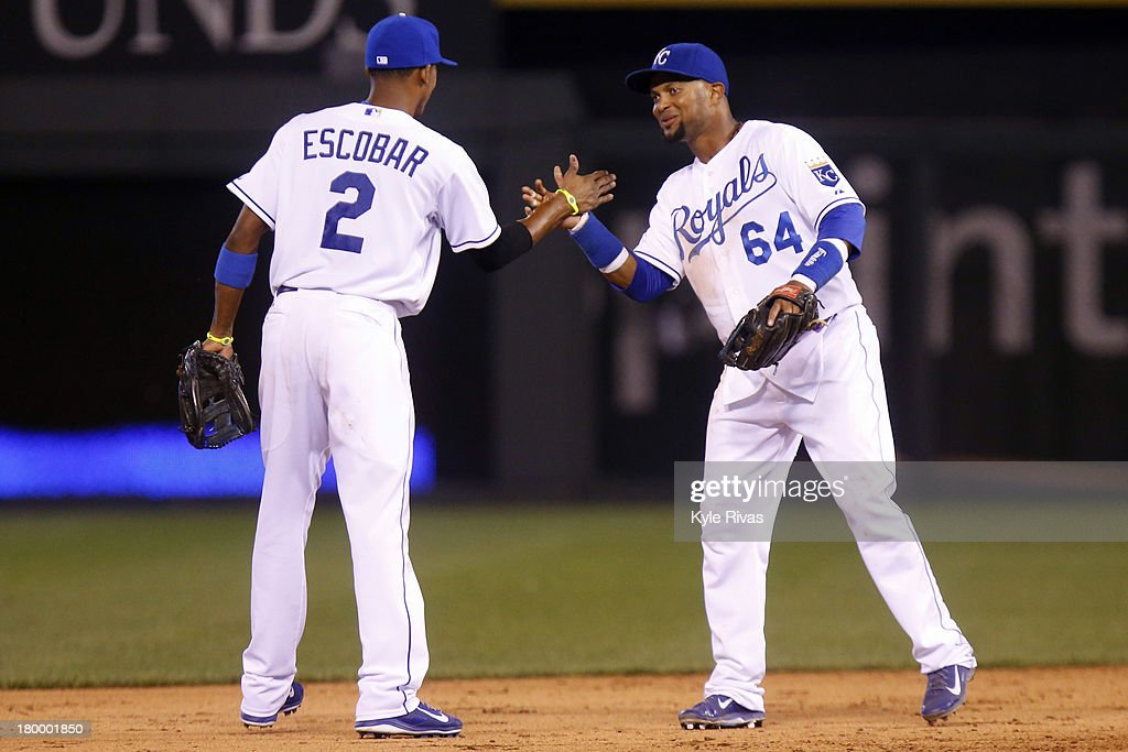 <a gi-track='captionPersonalityLinkClicked' href=/galleries/search?phrase=Alcides+Escobar&family=editorial&specificpeople=4845889 ng-click='$event.stopPropagation()'>Alcides Escobar</a> #2 and <a gi-track='captionPersonalityLinkClicked' href=/galleries/search?phrase=Emilio+Bonifacio&family=editorial&specificpeople=4193706 ng-click='$event.stopPropagation()'>Emilio Bonifacio</a> #64 of the Kansas City Royals celebrate the 4 to 3 victory over the Detroit Tigers on September 7, 2013 at Kauffman Stadium in Kansas City, Missouri.
