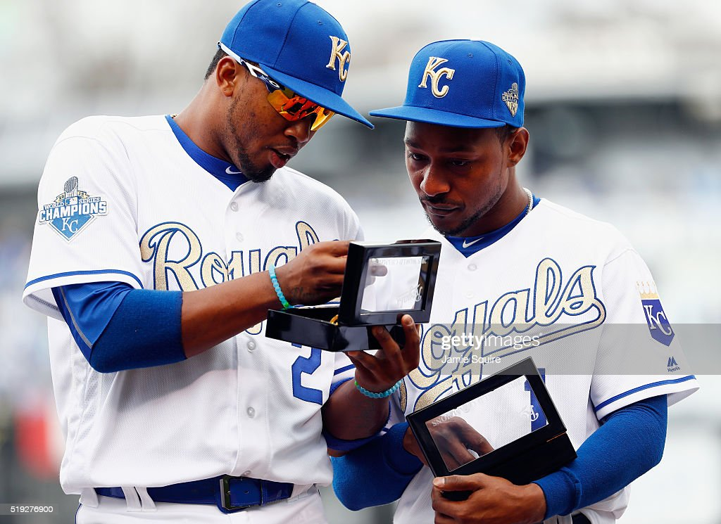 <a gi-track='captionPersonalityLinkClicked' href=/galleries/search?phrase=Alcides+Escobar&family=editorial&specificpeople=4845889 ng-click='$event.stopPropagation()'>Alcides Escobar</a> #2 and <a gi-track='captionPersonalityLinkClicked' href=/galleries/search?phrase=Jarrod+Dyson&family=editorial&specificpeople=6780110 ng-click='$event.stopPropagation()'>Jarrod Dyson</a> #1 of the Kansas City Royals inspect their 2015 World Series Championship rings during a ring ceremony prior to the game between the Royals and the New York Mets at Kauffman Stadium on April 5, 2016 in Kansas City, Missouri.