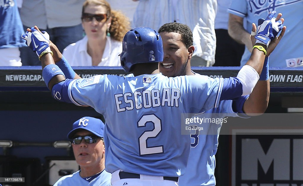 <a gi-track='captionPersonalityLinkClicked' href=/galleries/search?phrase=Alcides+Escobar&family=editorial&specificpeople=4845889 ng-click='$event.stopPropagation()'>Alcides Escobar</a> #2 celebrates his home run with Salvador Perez #13 of the Kansas City Royals in the fifth inning during game one of a doubleheader against the Cleveland Indians at Kauffman Stadium on April 28, 2013 in Kansas City, Missouri.