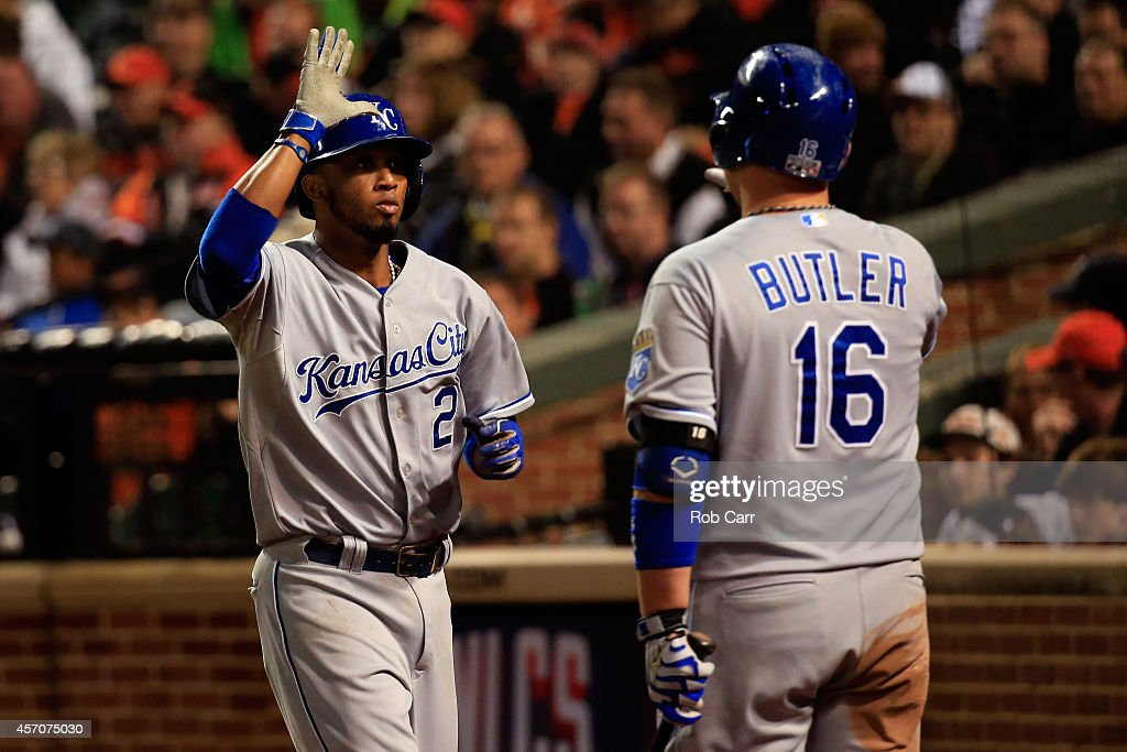 <a gi-track='captionPersonalityLinkClicked' href=/galleries/search?phrase=Alcides+Escobar&family=editorial&specificpeople=4845889 ng-click='$event.stopPropagation()'>Alcides Escobar</a> #2 celebrates with teammate <a gi-track='captionPersonalityLinkClicked' href=/galleries/search?phrase=Billy+Butler&family=editorial&specificpeople=759092 ng-click='$event.stopPropagation()'>Billy Butler</a> #16 after scoring on Lorenzo Cain #6 of the Kansas City Royals RBI single to left field in the ninth inning against Zach Britton #53 of the Baltimore Orioles during Game Two of the American League Championship Series at Oriole Park at Camden Yards on October 11, 2014 in Baltimore, Maryland.