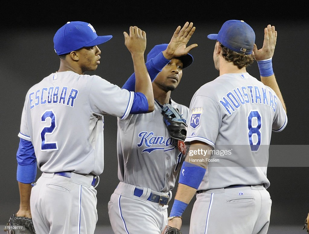 <a gi-track='captionPersonalityLinkClicked' href=/galleries/search?phrase=Alcides+Escobar&family=editorial&specificpeople=4845889 ng-click='$event.stopPropagation()'>Alcides Escobar</a> #2, Jarrod Dyson #1 and <a gi-track='captionPersonalityLinkClicked' href=/galleries/search?phrase=Mike+Moustakas&family=editorial&specificpeople=6780077 ng-click='$event.stopPropagation()'>Mike Moustakas</a> #8 of the Kansas City Royals celebrate a win of the game against the Minnesota Twins on July 31, 2013 at Target Field in Minneapolis, Minnesota. The Royals defeated the Twins 4-3.