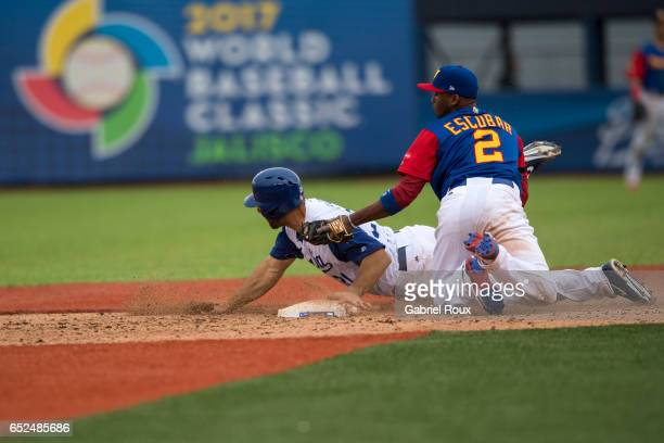 Alcides Escobar of Team Venezuela tags out Robert Segedin of Team Italy at second base during Game 3 Pool D of the 2017 World Baseball Classic on...